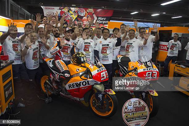 Marc Marquez of Spain and Repsol Honda Team celebrates in box the victory with team at the end of the MotoGP race and the victory of the 2016 World...
