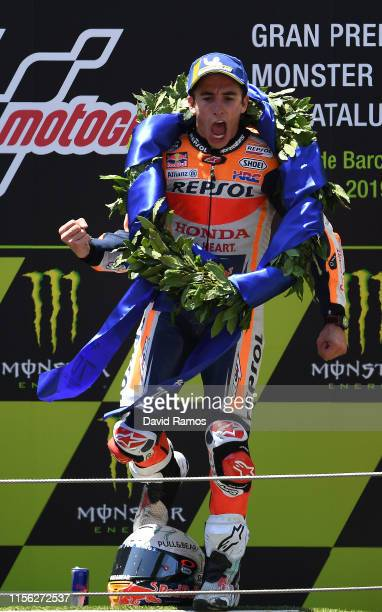 Marc Marquez of Spain and Repsol Honda Team celebrates on the podium after winning the MotoGP race during the MotoGP Gran Premi Monster Energy de...