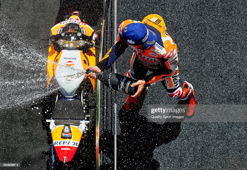 Marc Marquez of Spain and Repsol Honda Team celebrates on the podium after the MotoGp race for the MotoGP of Catalunya at Circuit de Catalunya on June 11, 2017 in Montmelo, Spain.