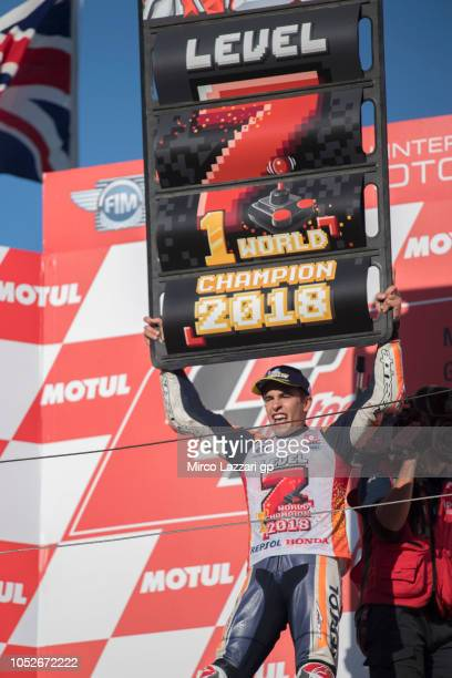 Marc Marquez of Spain and Repsol Honda Team celebrates the MotoGP victory and becoming the 2018 MotoGP champion at the end of the MotoGP race on the...