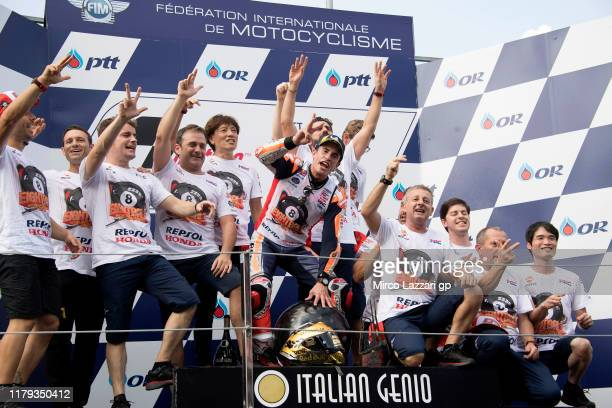 Marc Marquez of Spain and Repsol Honda Team celebrates the MotoGP victory and the 2019 MotoGP Championship on the podium with team at the end of the...