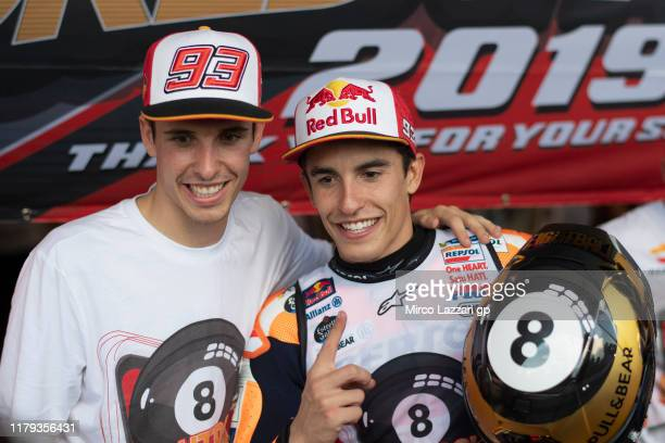 Marc Marquez of Spain and Repsol Honda Team celebrates the MotoGP victory and the 2019 MotoGP Championship with his brother Alex Marquez at the end...