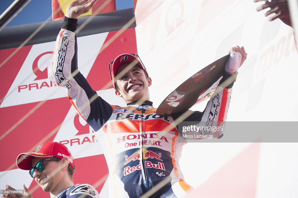 Marc Marquez of Spain and Repsol Honda Team celebrates the victory on the podium at the end of the MotoGP race during the MotoGP of Australia - Race during the 2015 MotoGP of Australia at Phillip Island Grand Prix Circuit on October 18, 2015 in Phillip Island, Australia.