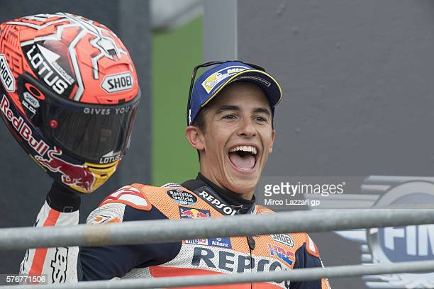Marc Marquez of Spain and Repsol Honda Team celebrates the victory on the podium at the end of the MotoGP race during the MotoGp of Germany Race at...