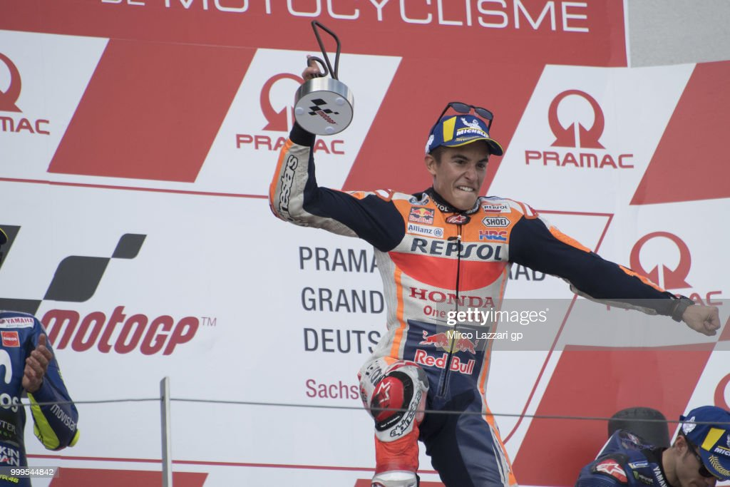 Marc Marquez of Spain and Repsol Honda Team celebrates the victory on the podium at the end of the MotoGP race during the MotoGp of Germany - Race at Sachsenring Circuit on July 15, 2018 in Hohenstein-Ernstthal, Germany.