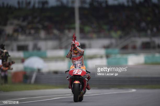 Marc Marquez of Spain and Repsol Honda Team celebrates the victory with flag at the end of the MotoGP race during the MotoGP Of Malaysia - Race at...