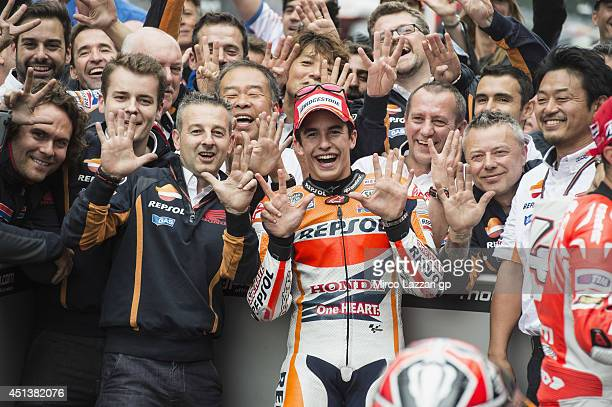 Marc Marquez of Spain and Repsol Honda Team celebrates the victory under the podium with team at the end of the MotoGp race during the MotoGP of...