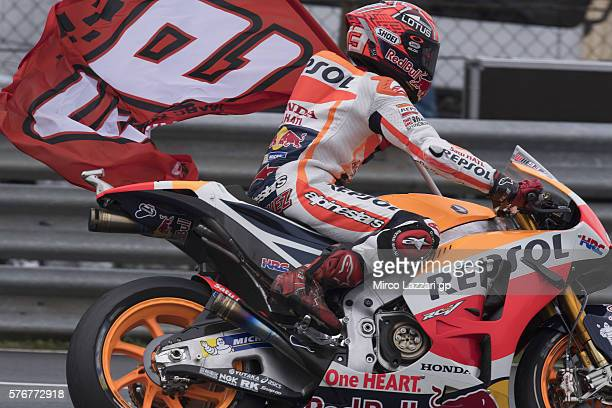 Marc Marquez of Spain and Repsol Honda Team celebrates the victory with flag at the end of the MotoGP race during the MotoGp of Germany Race at...