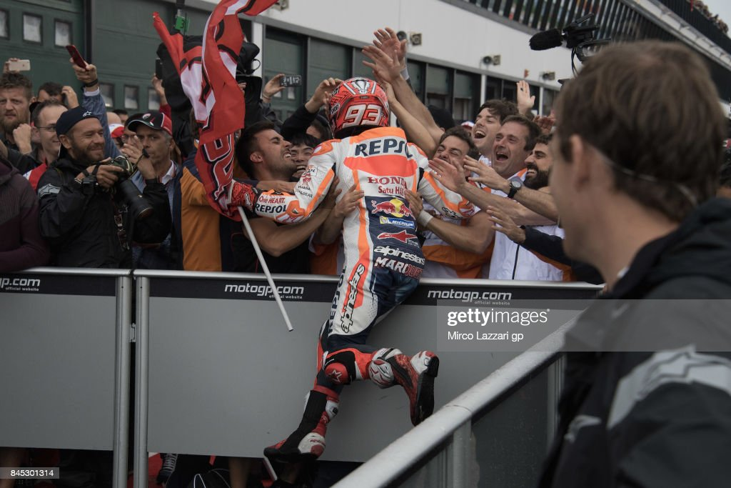 Marc Marquez of Spain and Repsol Honda Team celebrates the victory under the podium with team at the end of the MotoGP Race during the MotoGP of San Marino - Race at Misano World Circuit on September 10, 2017 in Misano Adriatico, Italy.