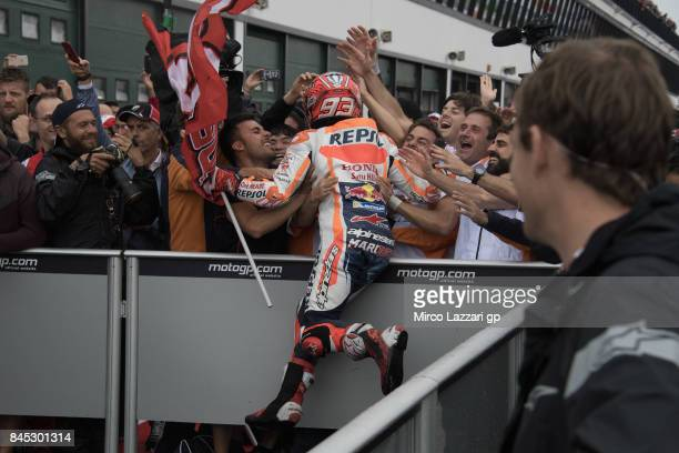 Marc Marquez of Spain and Repsol Honda Team celebrates the victory under the podium with team at the end of the MotoGP Race during the MotoGP of San...