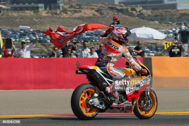 Marc Marquez of Spain and Repsol Honda Team celebrates the victory with flag at the end of the MotoGP race during the MotoGP of Aragon Race at...