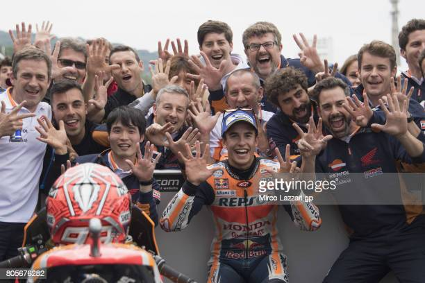 Marc Marquez of Spain and Repsol Honda Team celebrates under the podium the victory at the end of the MotoGP race during the MotoGp of Germany Race...