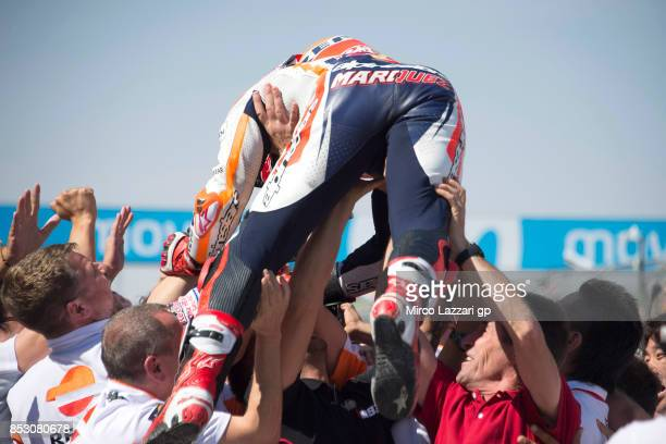 Marc Marquez of Spain and Repsol Honda Team celebrates victory with the team under the podium at the MotoGP of Aragon Race at Motorland Aragon...