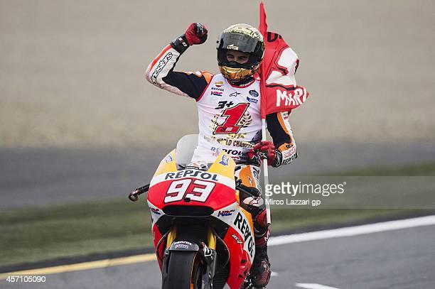 Marc Marquez of Spain and Repsol Honda Team celebrates wininning the 2014 MotoGP championship at the end of the MotoGP race during the MotoGP Of...