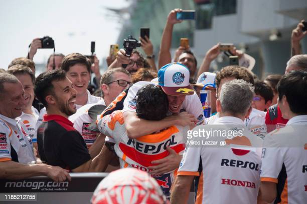 Marc Marquez of Spain and Repsol Honda Team celebrates with his brother Alex Marquez under the podium at the end of the MotoGP race during the MotoGP...