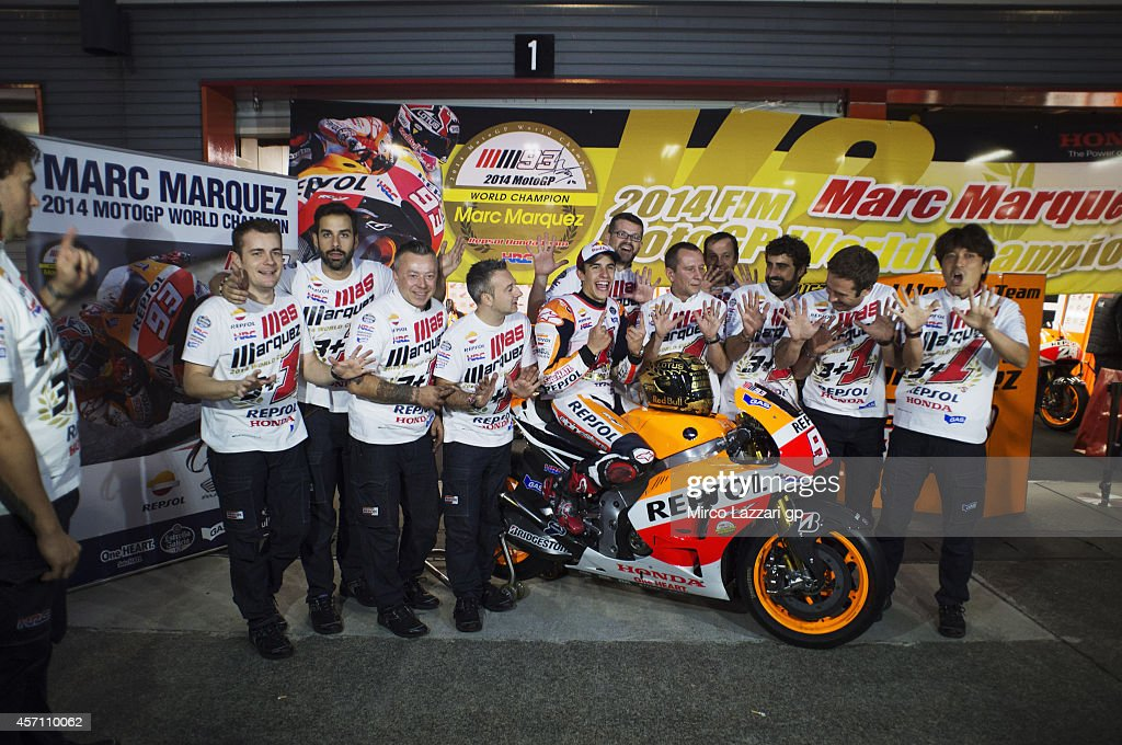 Marc Marquez of Spain and Repsol Honda Team celebrates with team the victory in the MotoGP championship at the end of the MotoGP race during the MotoGP Of Japan - Race at Twin Ring Motegi on October 12, 2014 in Motegi, Japan.