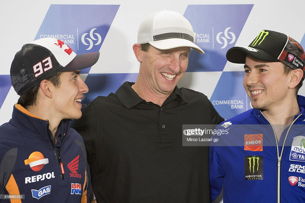 Marc Marquez of Spain and Repsol Honda Team, Colin Edwards of USA and Jorge Lorenzo of Spain and Movistar Yamaha MotoGP smile during the press conference at the end of the qualifying practice during the MotoGp of Qatar - Qualifying at Losail Circuit on March 19, 2016 in Doha, Qatar.