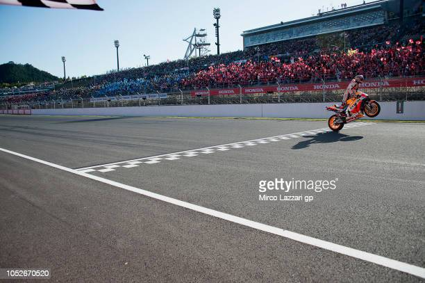 Marc Marquez of Spain and Repsol Honda Team cuts the finish lane anc celebrates the MotoGP victory and becoming the 2018 MotoGP champion at the end...