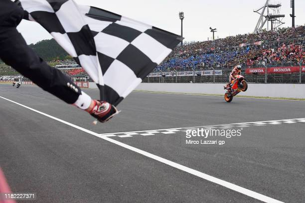 Marc Marquez of Spain and Repsol Honda Team cuts the finish lane and celebrates the victory at the end of the MotoGp race during the MotoGP of Japan...