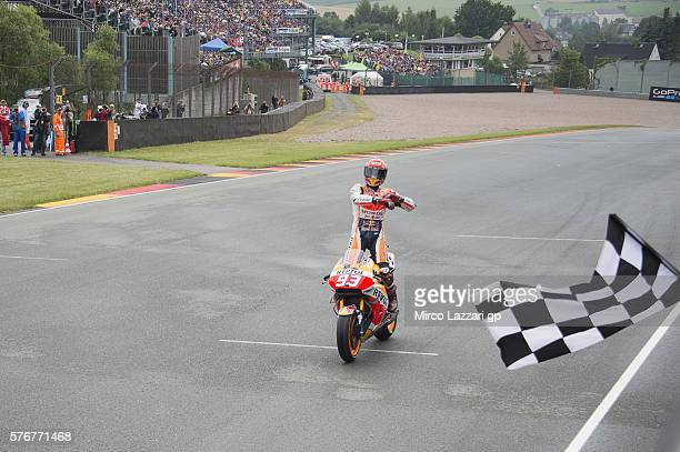 Marc Marquez of Spain and Repsol Honda Team cuts the finish lane and celebrates the victory at the end of the MotoGP race during the MotoGp of...