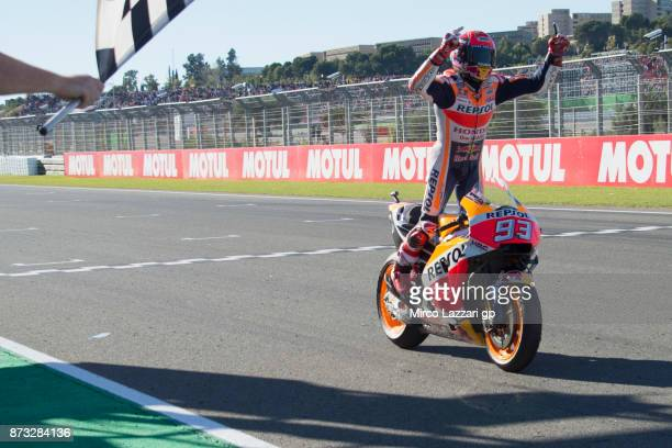 Marc Marquez of Spain and Repsol Honda Team cuts the finish lane and celebrates the third place at the end of the MotoGp race and the victory of the...