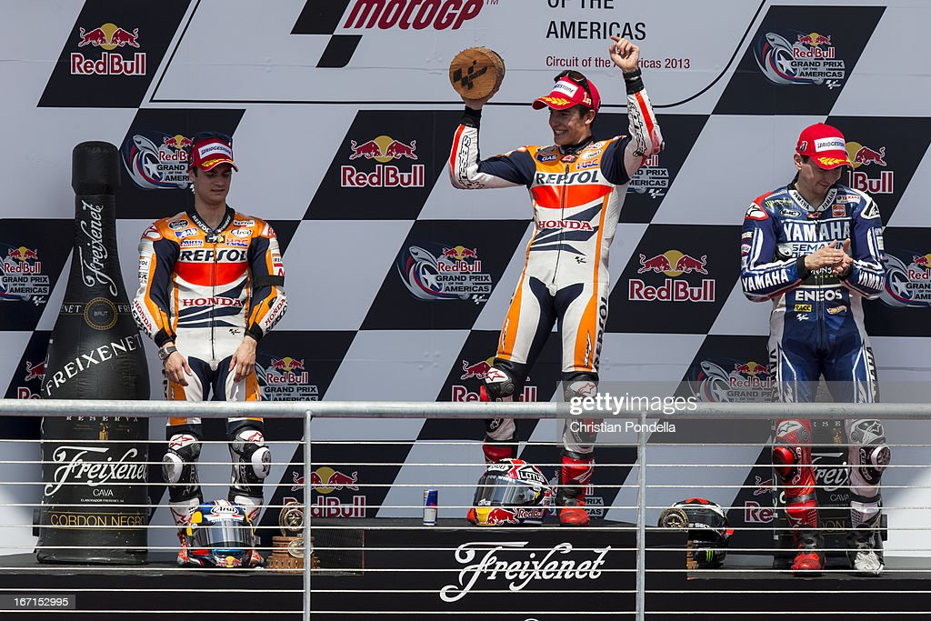 Marc Marquez (1) of Spain and Repsol Honda Team, Dani Pedrosa (2) of Spain and Repsol Honda Team, and Jorge Lorenzo (3) of Spain and Yamaha Tech Team on the podium after the MotoGP Red Bull U.S. Grand Prix of The Americas - Race at Circuit of The Americas on April 21, 2013 in Austin, Texas.