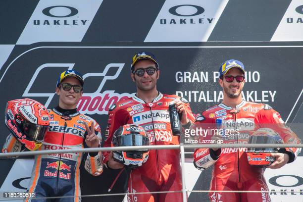 Marc Marquez of Spain and Repsol Honda Team Danilo Petrucci of Italy and Ducati Team and Andrea Dovizioso of Italy and Ducati Team celebrate on the...
