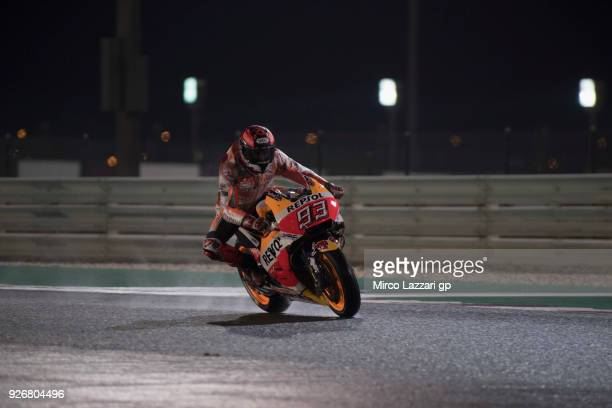 Marc Marquez of Spain and Repsol Honda Team heads down a straight and test the wet track during the Moto GP Testing Qatar at Losail Circuit on March...