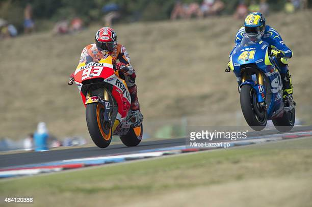 Marc Marquez of Spain and Repsol Honda Team leads Aleix Espargaro of Spain and Team Suzuki MotoGP during the MotoGp of Czech Republic Qualifying at...