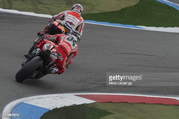 Marc Marquez of Spain and Repsol Honda Team leads Andrea Dovizioso of Italy and Ducati Marlboro Team during the MotoGP race during the MotoGp Of...