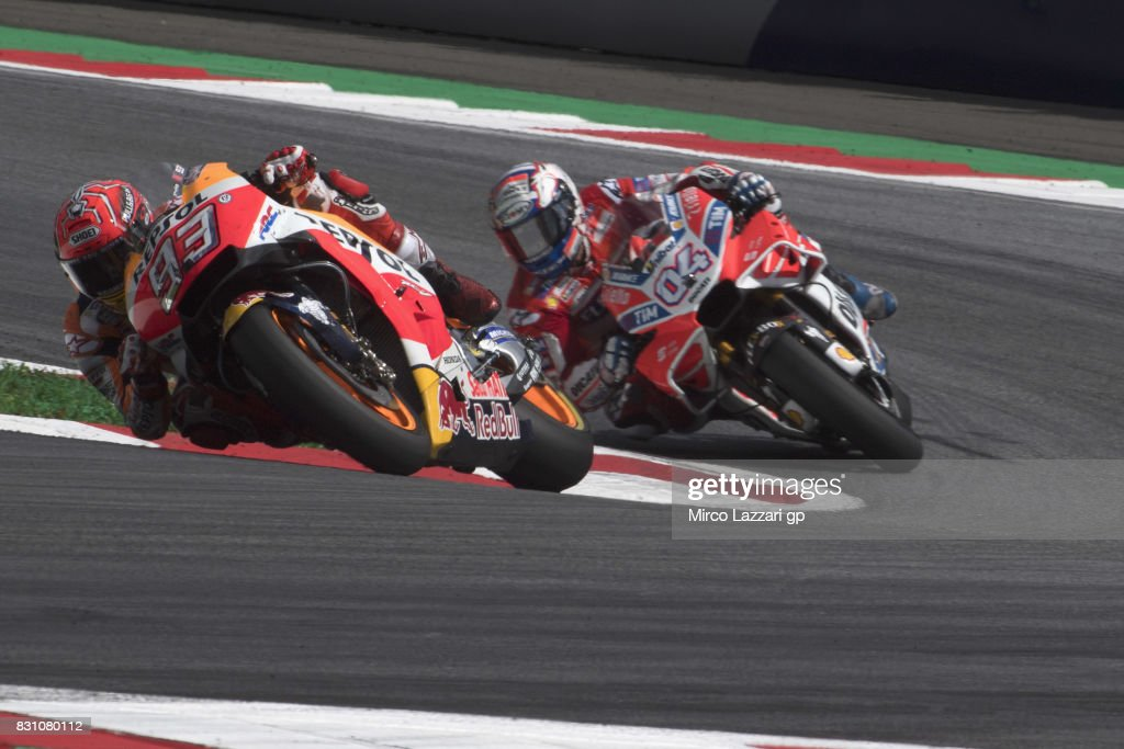 Marc Marquez of Spain and Repsol Honda Team leads Andrea Dovizioso of Italy and Ducati Team during the MotoGP race during the MotoGp of Austria - Race at Red Bull Ring on August 13, 2017 in Spielberg, Austria.