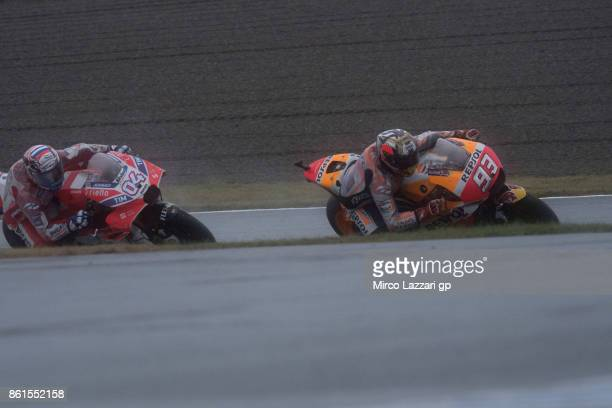 Marc Marquez of Spain and Repsol Honda Team leads Andrea Dovizioso of Italy and Ducati Team during the end of the MotoGP race during the MotoGP of...