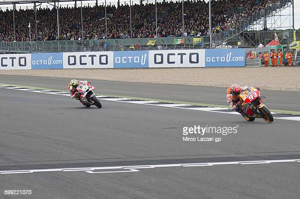Marc Marquez of Spain and Repsol Honda Team leads Andrea Iannone of Italy and Ducati Team during the MotoGP race during the MotoGp Of Great Britain...