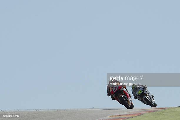 Marc Marquez of Spain and Repsol Honda Team leads Cal Crutchlow of Great Britain and CWM LCR Honda during the MotoGp of Germany Qualifying at...