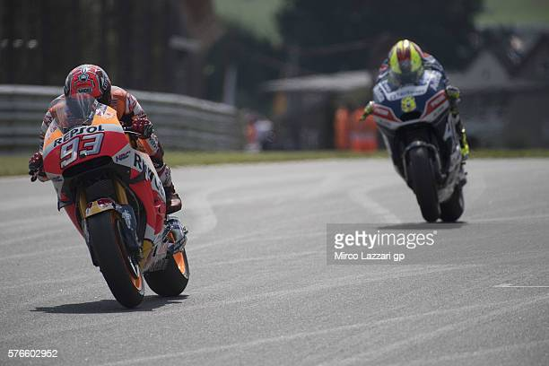 Marc Marquez of Spain and Repsol Honda Team leads Hector Barbera of Spain and Avintia Racing during the MotoGp of Germany Qualifying at Sachsenring...