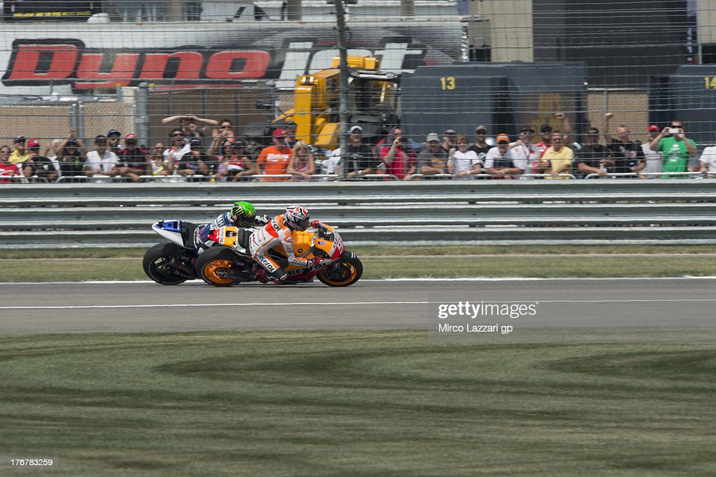 Marc Marquez of Spain and Repsol Honda Team leads Jorge Lorenzo of Spain and Yamaha Factory Racing during the MotoGP race during the MotoGp Red Bull U.S. Indianapolis Grand Prix - Race at Indianapolis Motor Speedway on August 18, 2013 in Indianapolis, Indiana.