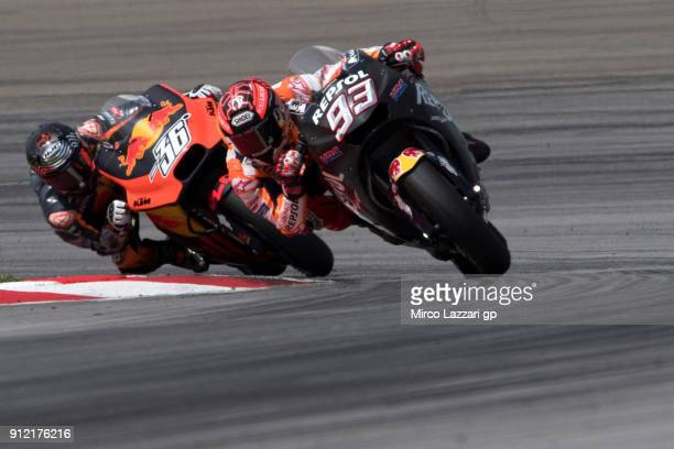 Marc Marquez of Spain and Repsol Honda Team leads Mika Kallio of Finland and Red Bull KTM Factory Racing during the MotoGP test in Sepang at Sepang...