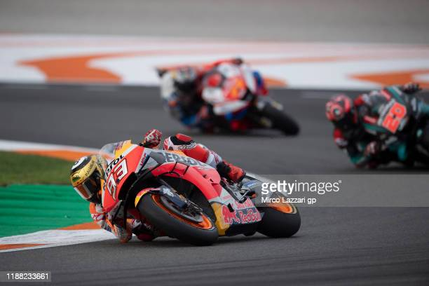 Marc Marquez of Spain and Repsol Honda Team leads the field during the MotoGP race during the MotoGP Of Valencia - Race at Ricardo Tormo Circuit on...