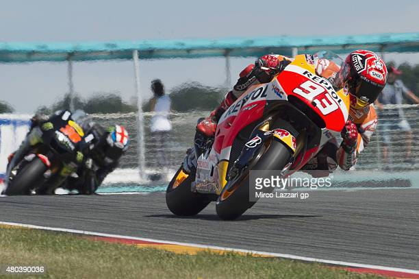 Marc Marquez of Spain and Repsol Honda Team leads the field during the MotoGp of Germany Qualifying at Sachsenring Circuit on July 11 2015 in...