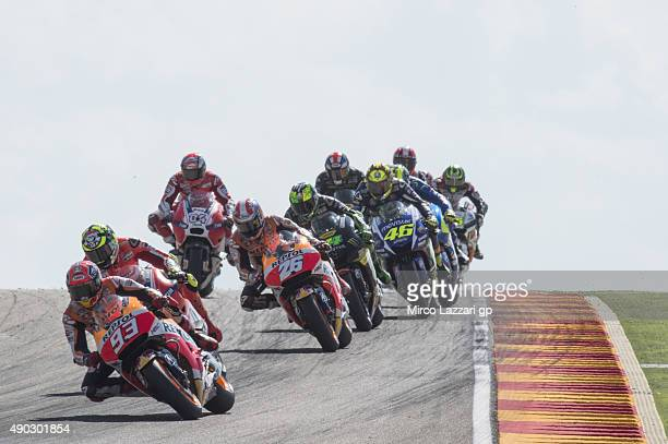 Marc Marquez of Spain and Repsol Honda Team leads the field during the MotoGP race during the MotoGP of Spain Race at Motorland Aragon Circuit on...