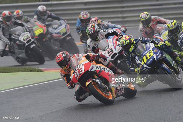 Marc Marquez of Spain and Repsol Honda Team leads the field during the MotoGP race during the MotoGp of Germany Race at Sachsenring Circuit on July...