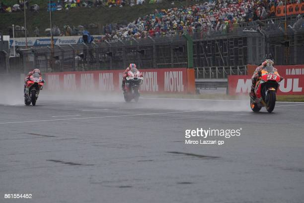 Marc Marquez of Spain and Repsol Honda Team leads the field during the MotoGP race during the MotoGP of Japan Race at Twin Ring Motegi on October 15...