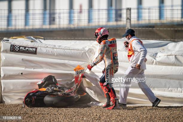 Marc Marquez of Spain and Repsol Honda Team looks at his bike after the crash at turn 4 during the Warm-up session at Circuito de Jerez on May 02,...