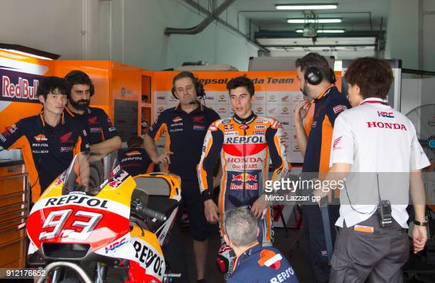 Marc Marquez of Spain and Repsol Honda Team looks on near the bike in the pit during the MotoGP test in Sepang at Sepang Circuit on January 30 2018...