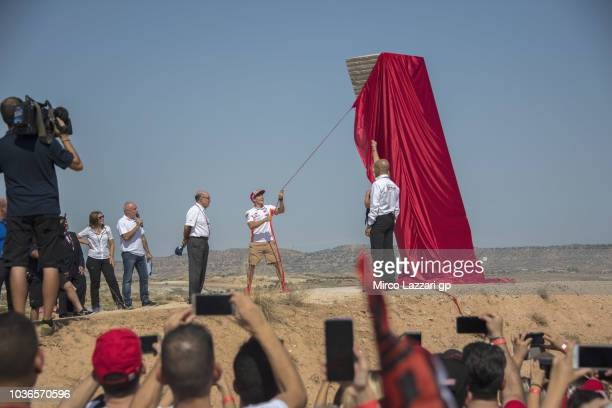 Marc Marquez of Spain and Repsol Honda Team makes the unveiling of the monument during the preevent 'Official naming of Marc Marquez Corner' during...