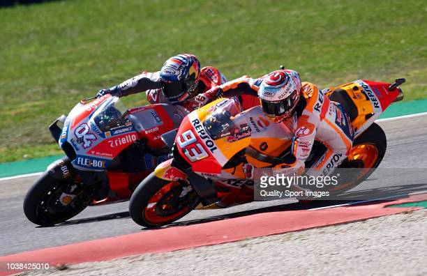 Marc Marquez of Spain and Repsol Honda Team overtake Andrea Dovizioso of Italy and Ducati Team during MotoGP race of the MotoGP Grand Prix of Aragon...