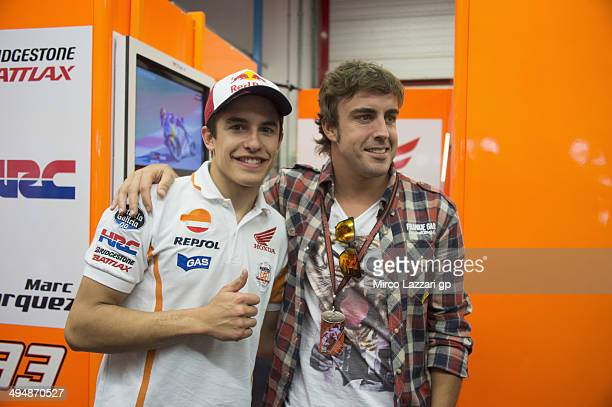 Marc Marquez of Spain and Repsol Honda Team poses with Fernando Alonso of Spain in MotoGP during the MotoGp of Italy Qualifying at Mugello Circuit on...