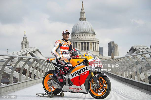 Marc Marquez of Spain and Repsol Honda Team poses with his bike at a photocall on the Millennium Bridge during previews for the MotoGp Of Great...