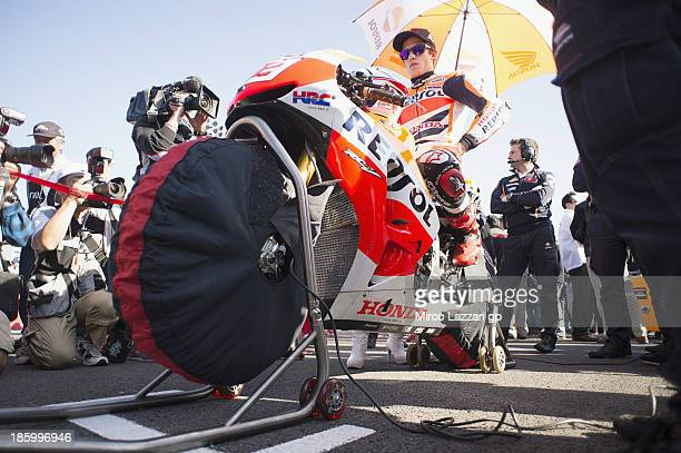 Marc Marquez of Spain and Repsol Honda Team prepares to start on the grid of the MotoGP race during the MotoGP of Japan at Twin Ring Motegi on...