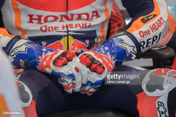 Marc Marquez of Spain and Repsol Honda Team prepares to start with Michael Doohan's gloves in box during the MotoGP qualifying during qualifying for...